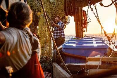 Joe and Joleen reeling in their fishing nets