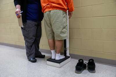 An incarcerated youth is weighed at the Fresno County juvenile hall in Fresno.