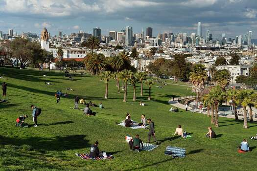 A few people in Mission Dolores Park on March 19, 2020 in San Francisco, California.
