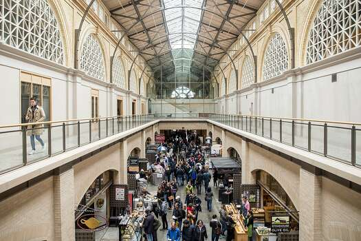 Hundreds make their way through shops inside the Ferry Building Saturday, March 3, 2018 in San Francisco, California.