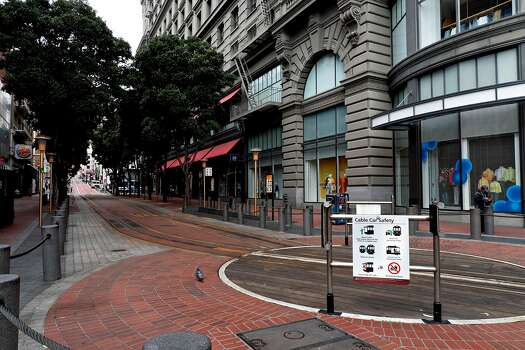 The Powell St. cable car turnaround is empty on Thursday, March 19, 2020, in San Francisco, California.