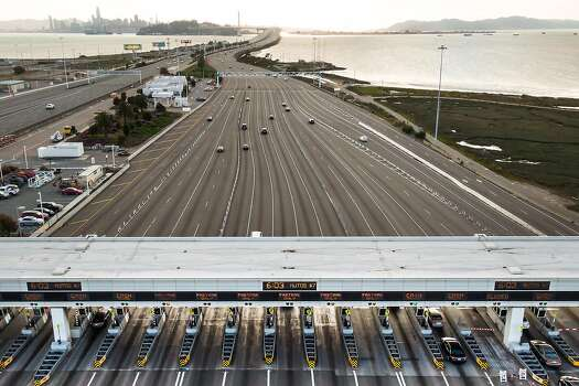 The Bay Bridge Toll Plaza had little traffic on the evening on March 19, 2020 in Oakland, California.