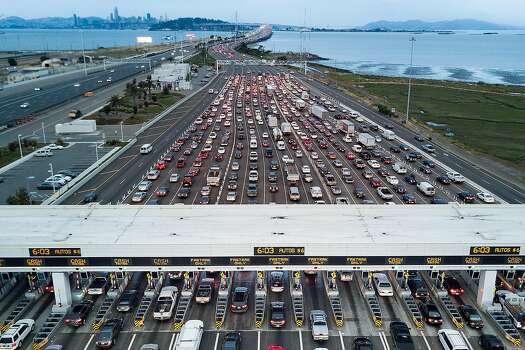 Heavy traffic flows through the Bay Bridge toll plaza on Thursday, June 8, 2017, in Oakland, California.