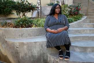 DaeJah Seward is pictured outside her workplace in Sacramento.