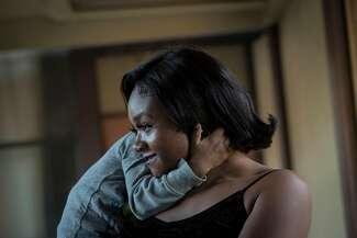 A photograph of Jasmine Murray-Thomas embracing her son.