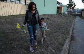 A photograph of Jasmine Murray-Thomas and her son, Jeremiah Micai Thomas, who is 3 years old.