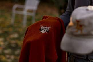 Photograph of a hat and sweatshirt with the Lakeside Academy logo.