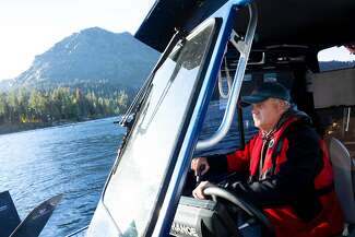 Keith Cormican of Bruce's Legacy steers back to shore after searching for the body of David Ward, who drowned in Fallen Leaf Lake in South Lake Tahoe after a boating accident in 1996.
