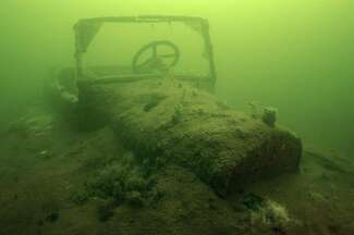 An underwater photo of a sunken car at the bottom of Lake Minnewanka in Alberta, Canada, captured by Keith Cormican in 2020.