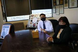 Jeannie Atienza, mother of Laudemer Arboleda, with her other son, Randy Arboleda, at the Oakland office of attorney John Burris, who is representing the shooting victim's family.