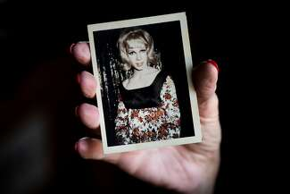 "Melissa Honrath holds a photo of Joseph ""Jae"" Stevens"