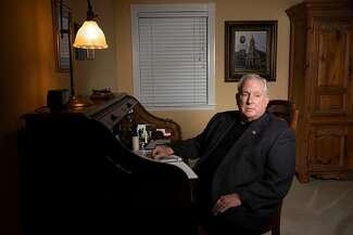 Portrait of Frank Falzon at a desk.