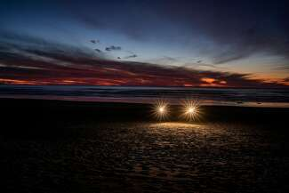 Strobes light up the approximate location of Klaus Christmann's crime scene at Ocean Beach
