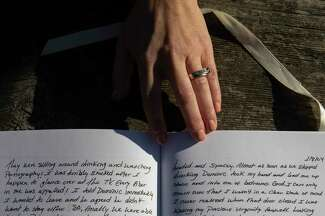 A woman who wished to remain anonymous holds her hand over her journal where she recorded details of her alleged sexual assault by Windsor Mayor Dominic Foppoli in 2004 while at an undisclosed park in Windsor.
