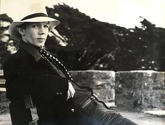 Jae Stevens poses in a white hat with a wide brim.