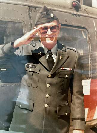 A portrait of U.S. Army Lt. Col. Howard Preece photographed next to an Army medical helicopter some time during his enlistment between 1980 and 1988.