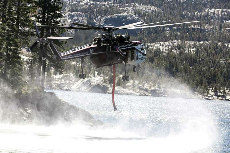 A map depicts the Caldor Fire perimeter on Sept. 1 and the location of the Kirkwood Mountain Resort. A photo shows a specialized heavy-lift helicopter with a drop hose.