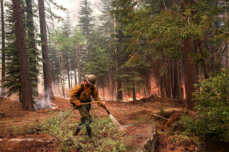 A map depicts the Caldor Fire perimeter on Sept. 1 and the location of the Meyers. A firefighter sprays water in a photo.