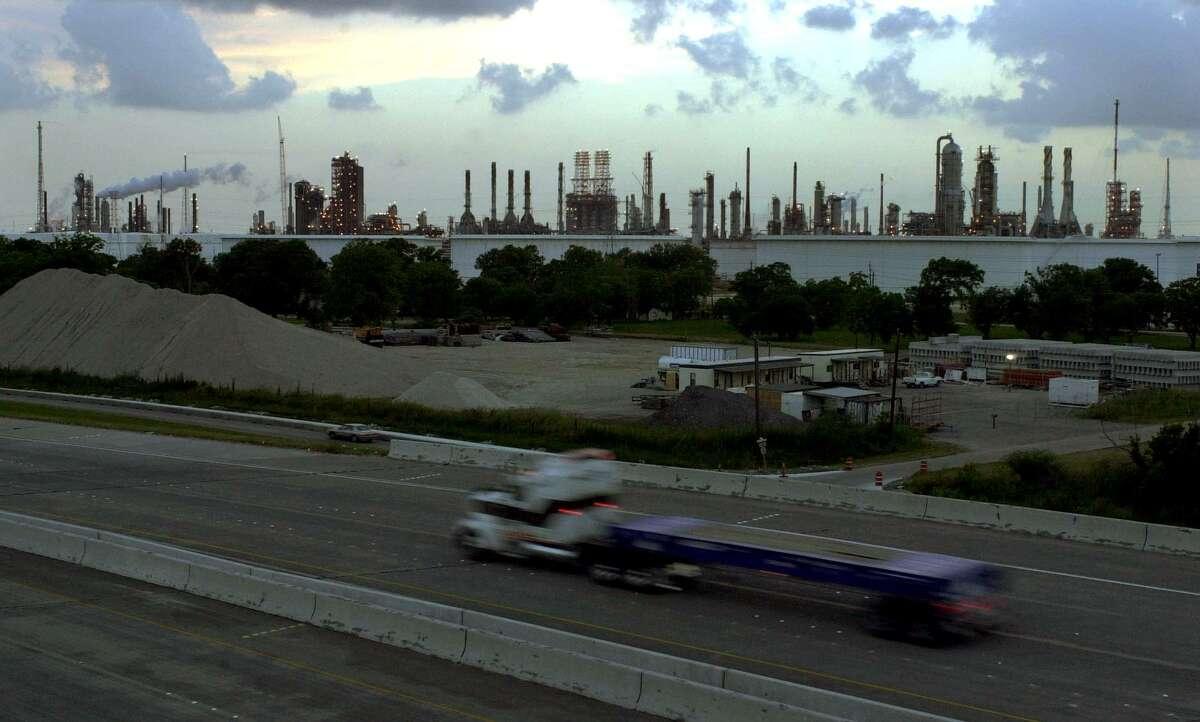 A truck passes by a portion Exxon Mobil's Baytown refinery.
