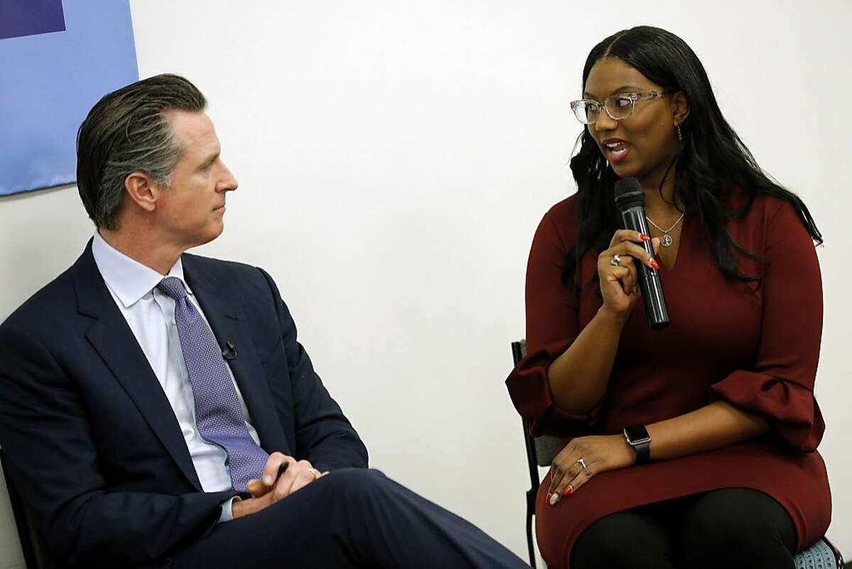 """Gov. Gavin Newsom listens in to Shavell K. Crawford, right, during a community meeting at the Seven Trees Community Center on Tuesday, Jan. 15, 2019, in San Jose, Calif. Alongside San Jose Mayor Sam Liccardo, Gov. Newsom met with people who are grappling with the state's housing crisis. At the event, the governor talked about housing proposals he laid out in the budget he submitted to the Legislature last week. Crawford is the executive assistant at """"Destination: Home"""" and a Lincoln Law School student."""