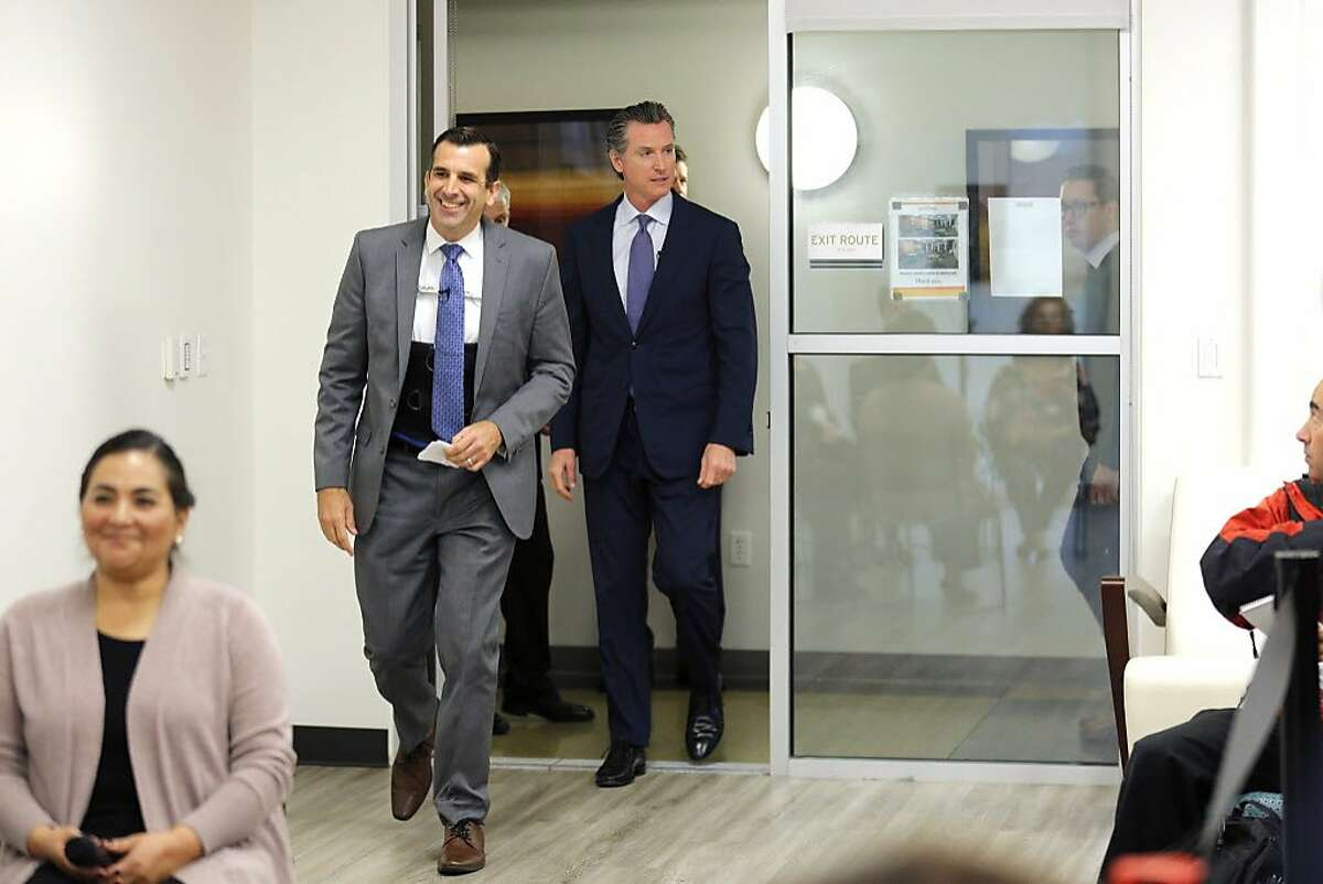 San Jose Mayor Sam Liccardo and Gov. Gavin Newsom during a community meeting at the Seven Trees Community Center on Tuesday, Jan. 15, 2019, in San Jose.The mayor is wearing a brace after being hit by a car while biking on New Year's Day.