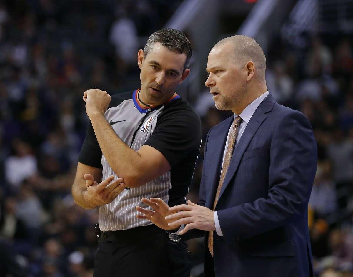 Denver Nuggets head coach Michael Malone in the first half during an NBA basketball game against the Phoenix Suns, Saturday, Jan. 12, 2019, in Phoenix. (AP Photo/Rick Scuteri)