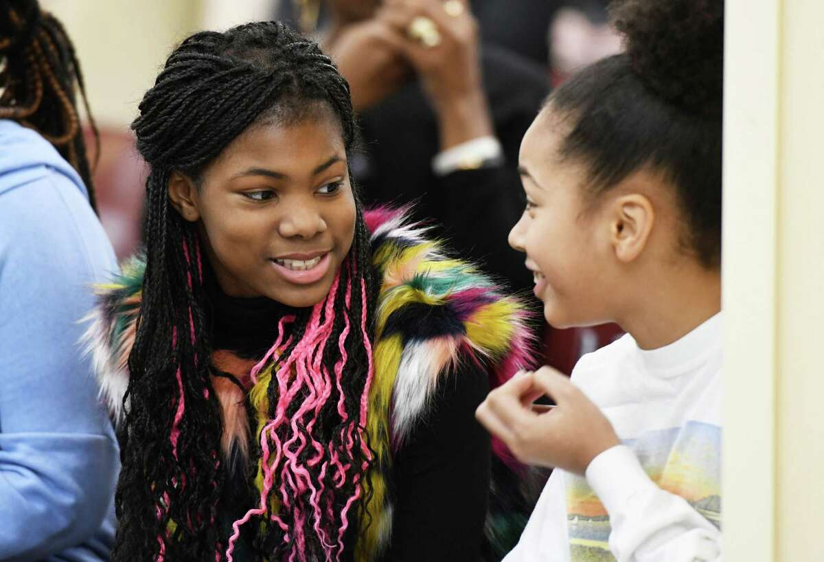 Neighoj Dye and Alexia Bynoe chat before the Dr. Martin Luther King, Jr's 90th birthday celebration Tuesday, Jan. 15, 2019 at the Albany County Office Building in Albany, N.Y. (Phoebe Sheehan/Times Union)