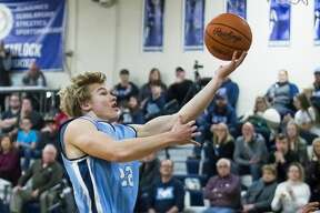 Meridian's Kyle Stockford takes a shot during a game against Hemlock on Tuesday, Jan. 15, 2019 at Hemlock High School. (Katy Kildee/kkildee@mdn.net)