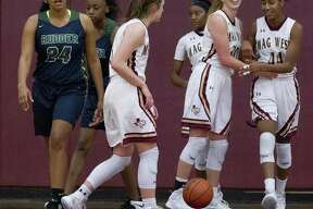 Magnolia West's Kamryn Jones (44) smiles beside Hannah Eggleston (30) after taking a charge Tuesday.
