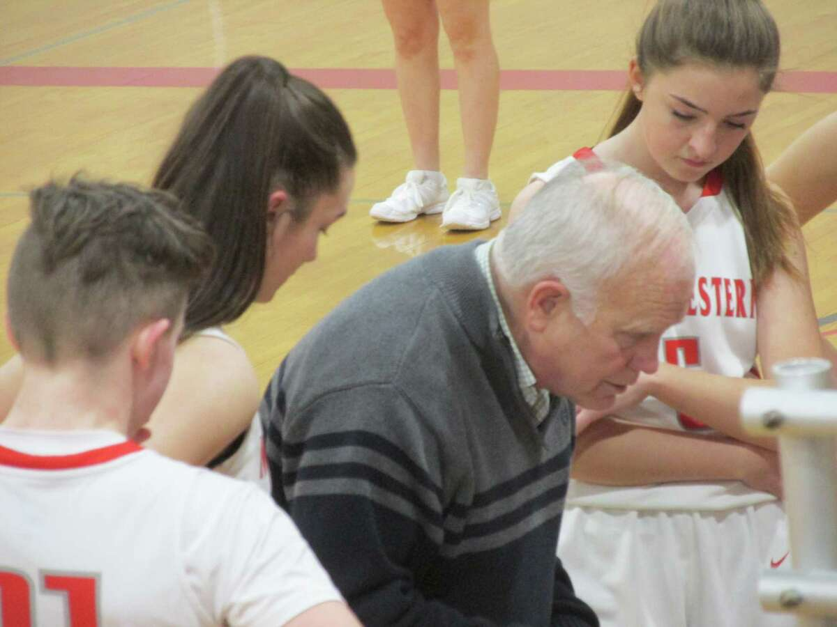 Northwestern coach Fred Williams maps the strategy for another Highlander victory, this time over Wamogo at Northwestern High School Tuesday night.