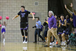 The Midland High bench clears after a victory against Lee Jan. 15, 2019, at Chaparral Center. James Durbin/Reporter-Telegram