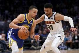 DENVER, COLORADO - JANUARY 15: Stephen Curry #30 of the Golden State Warriors drives against Jamal Murray #27 of the Denver Nuggets in the first quarter at the Pepsi Center on January 15, 2019 in Denver, Colorado. NOTE TO USER: User expressly acknowledges and agrees that, by downloading and or using this photograph, User is consenting to the terms and conditions of the Getty Images License Agreement. (Photo by Matthew Stockman/Getty Images)