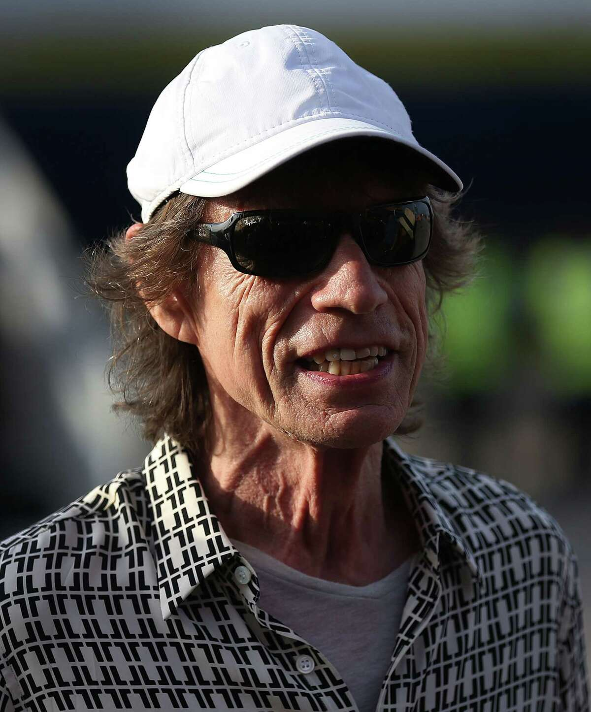 HAVANA, CUBA - MARCH 24: Mick Jagger of the Rolling Stones talks to media after landing at the Jose Marti International Airport on March 24, 2016 in Havana, Cuba. The Rolling Stones are in Havana to play a free concert for the first time, after the music was once banned by the Cuban government. (Photo by Joe Raedle/Getty Images) ORG XMIT: 618018865
