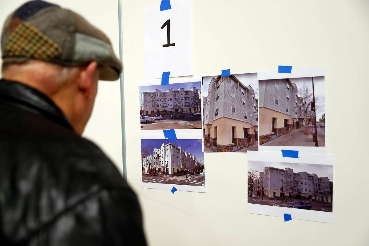 A community member looks at one of the twenty five proposals submitted for housing at North Berkeley BART station before Berkeley City Council meeting in Berkeley, Calif., on Tuesday, January 15, 2019.