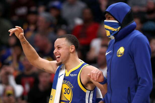 DENVER, COLORADO - JANUARY 15: Stephen Curry #30 of the Golden State Warriors celebrates on the bench against the Denver Nuggets in the fourth quarter at the Pepsi Center on January 15, 2019 in Denver, Colorado. NOTE TO USER: User expressly acknowledges and agrees that, by downloading and or using this photograph, User is consenting to the terms and conditions of the Getty Images License Agreement. (Photo by Matthew Stockman/Getty Images)