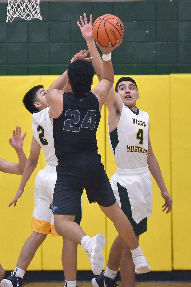 Chuy Trevino led United South with 23 points as the Panthers defeated Nixon 78-70. United South ends the first round of district play 2-4 and 18-11 overall. Photo: Cuate Santos /Laredo Morning Times / Laredo Morning Times