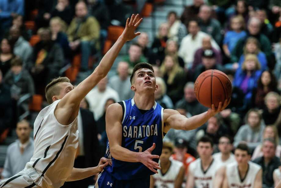 Saratoga's Aidan Homes goes for a basket past a Bethlehem player as the teams faced off at Bethlehem High School in Delmar, NY Tuesday, January 15th, 2019. Photo by Eric Jenks, for the Times Union Photo: Eric Jenks / Eric Jenks 2019