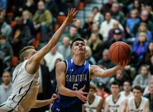 Saratoga's Aidan Homes goes for a basket past a Bethlehem player as the teams faced off at Bethlehem High School in Delmar, NY Tuesday, January 15th, 2019. Photo by Eric Jenks, for the Times Union