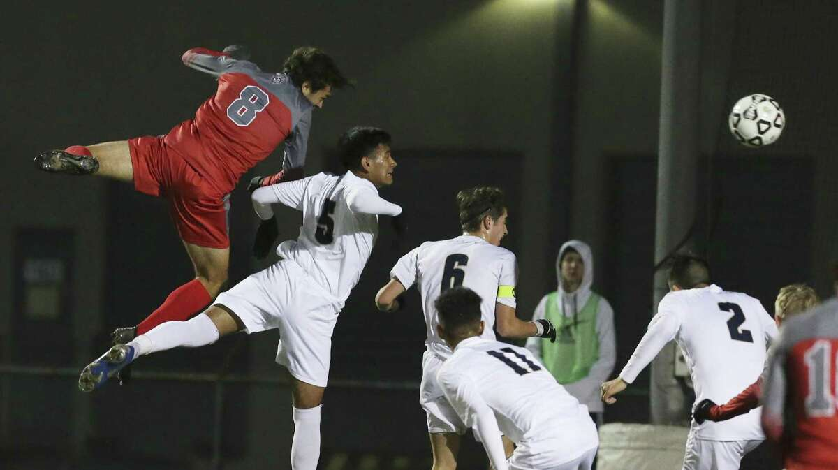 Legacy of Educational Excellence (LEE) player Brook Williams (08) attempts a header at the goal against Central Catholic's Chris Rios-Cruz (05) in boys soccer at Blossom Soccer Complex on Tuesday, Jan. 15, 2019. Central Catholic was No. 1 in the nation last week and is two-time defending TAPPS-I state champion. LEE was a regional finalist a year ago, losing to Reagan 1-0 and falling one win shy of advancing to the UIL Class 6A state tournament. LEE defeated Central Catholic 2-1. (Kin Man Hui/San Antonio Express-News)