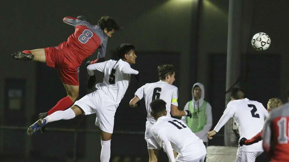 Legacy of Educational Excellence (LEE) player Brook Williams (08) attempts a header at the goal against Central Catholic's Chris Rios-Cruz (05) in boys soccer at Blossom Soccer Complex on Tuesday, Jan. 15, 2019. Central Catholic was No. 1 in the nation last week and is two-time defending TAPPS-I state champion. LEE was a regional finalist a year ago, losing to Reagan 1-0 and falling one win shy of advancing to the UIL Class 6A state tournament. LEE defeated Central Catholic 2-1. (Kin Man Hui/San Antonio Express-News) Photo: Kin Man Hui, Staff Photographer / San Antonio Express-News / ©2019 San Antonio Express-News