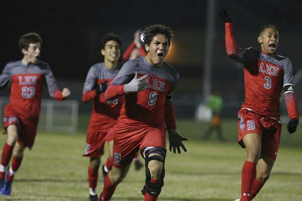 Legacy of Educational Excellence (LEE) player's Francisco Segura (09) and Theo Gunter (03) celebrate after Segura scores the eventual winning goal against Central Catholic in boys soccer at Blossom Soccer Complex on Tuesday, Jan. 15, 2019. Central Catholic was No. 1 in the nation last week and is two-time defending TAPPS-I state champion. LEE was a regional finalist a year ago, losing to Reagan 1-0 and falling one win shy of advancing to the UIL Class 6A state tournament. LEE defeated Central Catholic 2-1. (Kin Man Hui/San Antonio Express-News)