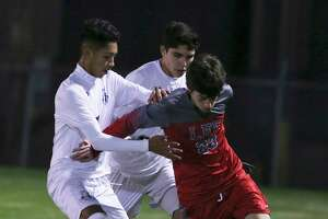 Legacy of Educational Excellence (LEE) player Henry Bowland (23) battles to keep control of the ball against Central Catholic's Angel Bacho (11) and Carlos Melo (04) in boys soccer at Blossom Soccer Complex on Tuesday, Jan. 15, 2019. Central Catholic was No. 1 in the nation last week and is two-time defending TAPPS-I state champion. LEE was a regional finalist a year ago, losing to Reagan 1-0 and falling one win shy of advancing to the UIL Class 6A state tournament. LEE defeated Central Catholic 2-1. (Kin Man Hui/San Antonio Express-News)