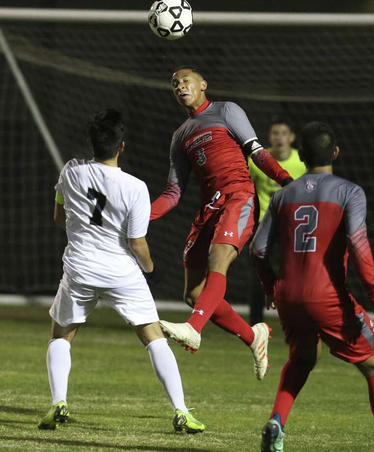 Legacy of Educational Excellence (LEE) player Theo Gunter (03) takes a header against Central Catholic's Jose Gallegos (07) in boys soccer at Blossom Soccer Complex on Tuesday, Jan. 15, 2019. Central Catholic was No. 1 in the nation last week and is two-time defending TAPPS-I state champion. LEE was a regional finalist a year ago, losing to Reagan 1-0 and falling one win shy of advancing to the UIL Class 6A state tournament. LEE defeated Central Catholic 2-1. (Kin Man Hui/San Antonio Express-News) Photo: Kin Man Hui, Staff Photographer / San Antonio Express-News / ©2019 San Antonio Express-News