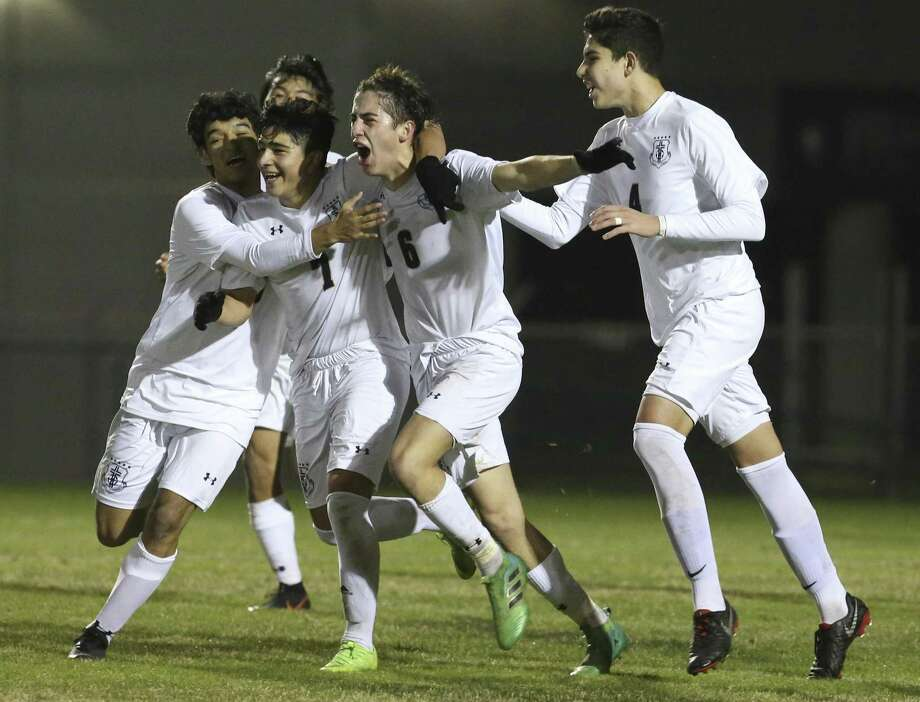 Central Catholic's Luis Jaen (06) gets rushed by teammates after scoring the game's first goal against Legacy of Educational Excellence (LEE) in boys soccer at Blossom Soccer Complex on Tuesday, Jan. 15, 2019. Central Catholic was No. 1 in the nation last week and is two-time defending TAPPS-I state champion. LEE was a regional finalist a year ago, losing to Reagan 1-0 and falling one win shy of advancing to the UIL Class 6A state tournament. LEE defeated Central Catholic 2-1. (Kin Man Hui/San Antonio Express-News) Photo: Kin Man Hui, Staff Photographer / San Antonio Express-News / ©2019 San Antonio Express-News