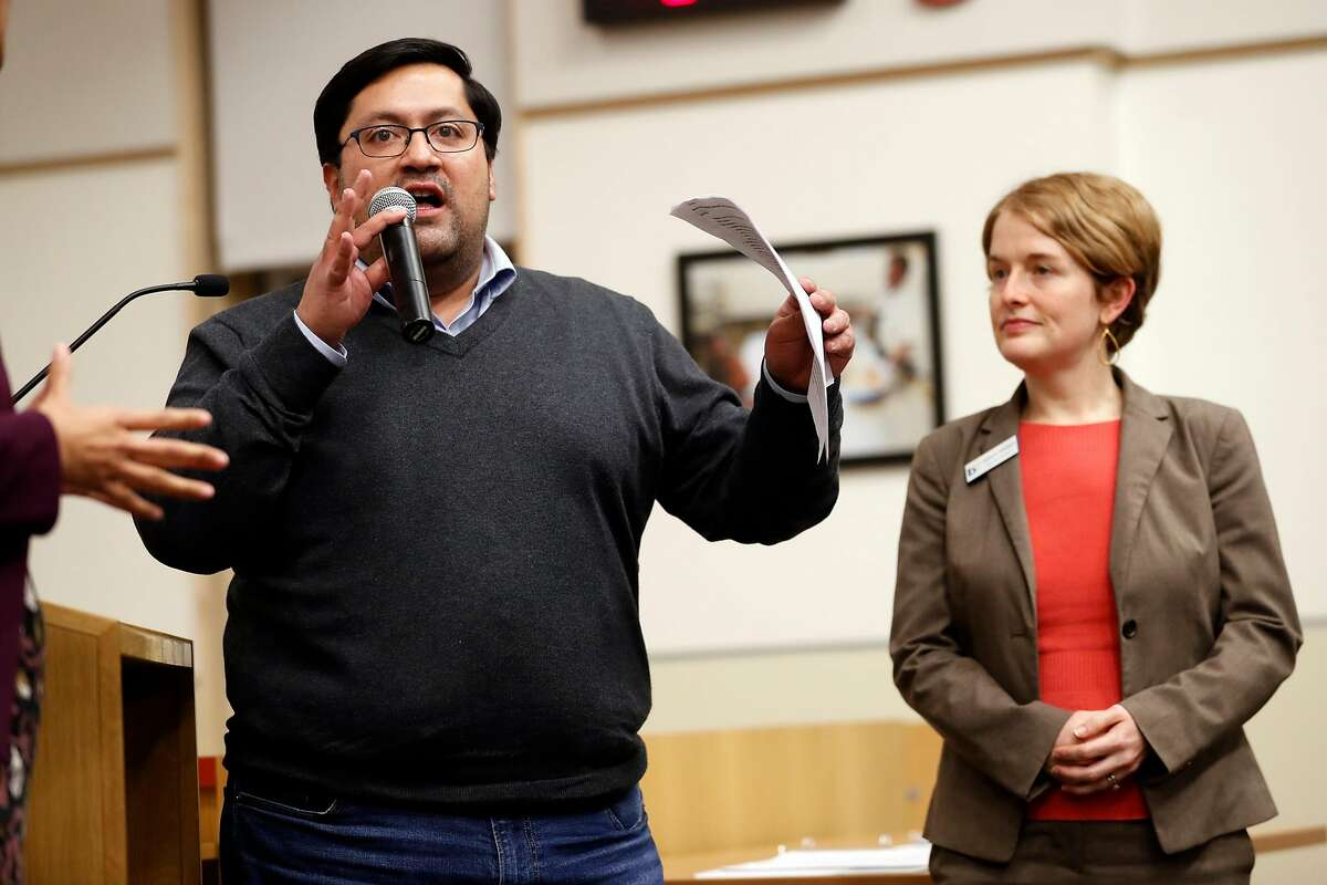 Berkeley Mayor Jesse Arreguin speaks about North Berkeley BART housing proposals as BART District 3 Director Rebecca Saltzmann listens during Berkeley City Council meeting in Berkeley, Calif., on Tuesday, January 15, 2019.