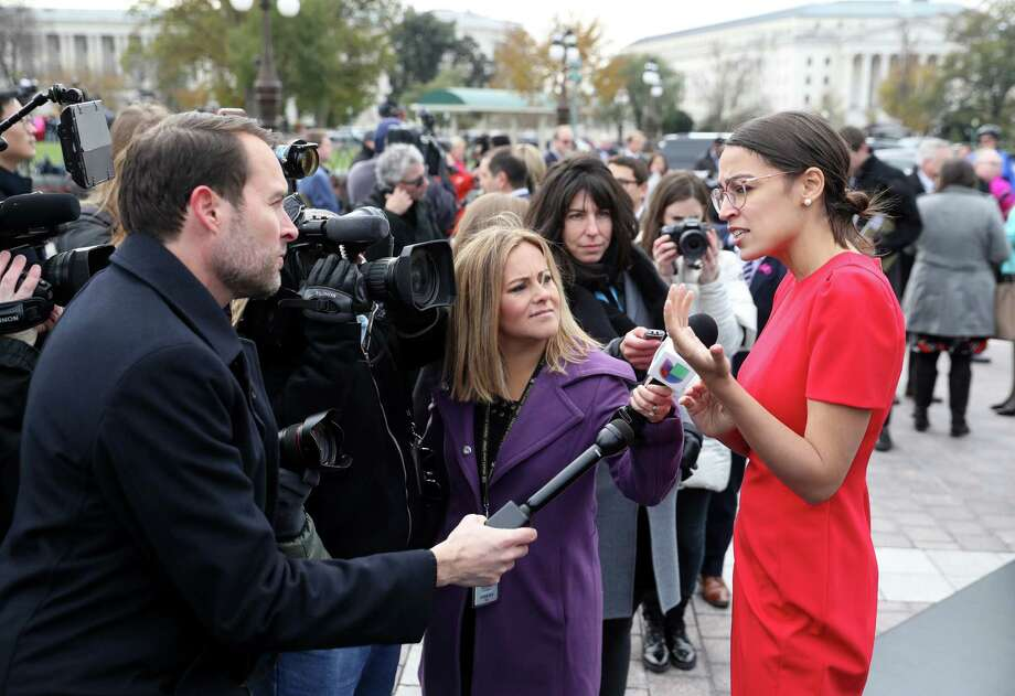 Representative-elect Alexandria Ocasio-Cortez, a Democrat from New York, speaks with members of the media after a group photo with the 116th Congress outside the U.S Capitol in Washington, D.C.,on Nov. 14, 2018. Photo: Bloomberg Photo By Andrew Harrer / Bloomberg