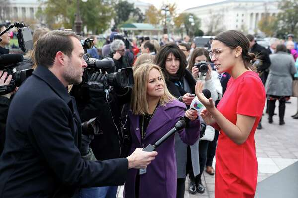Representative-elect Alexandria Ocasio-Cortez, a Democrat from New York, speaks with members of the media after a group photo with the 116th Congress outside the U.S Capitol in Washington, D.C.,on Nov. 14, 2018.
