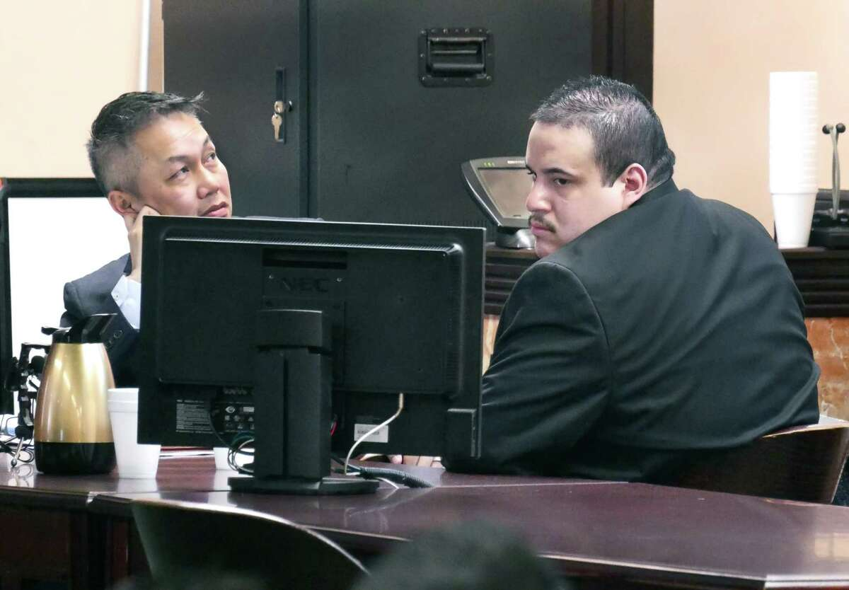 Mario Angel Gonzalez, right, and his attorney sit in the 49th District Courtroom where Gonzalez is on trial for the alleged murder of 16-year-old Lesley Sanchez.