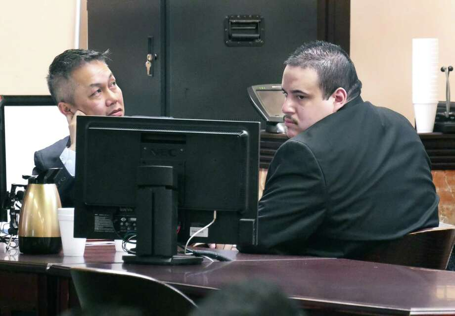 Mario Angel Gonzalez, right, and his attorney sit in the 49th District Courtroom where Gonzalez is on trial for the alleged murder of 16-year-old Lesley Sanchez. Photo: Cuate Santos, Laredo Morning Times / Laredo Morning Times