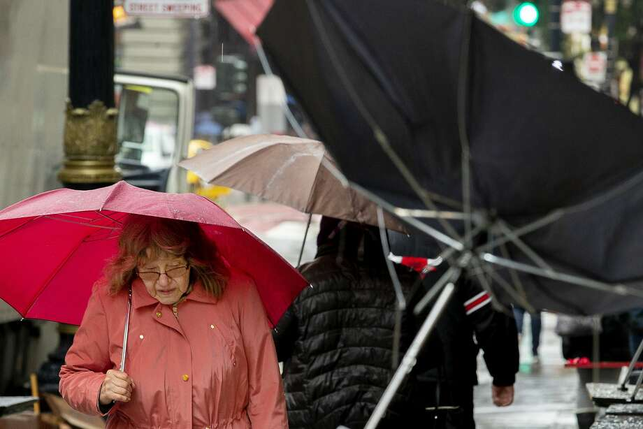 People make their way through the rain in downtown on Tuesday, Jan. 15, 2019, in San Francisco, Calif. Photo: Santiago Mejia / The Chronicle